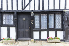 An old wooden with black door house seen in Rye, Kent, UK. An old wooden with black door house seen in Rye, Kent, UK on a summer day Stock Image