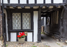 An old wooden with black door house seen in Rye, Kent, UK. An old wooden with black door house seen in Rye, Kent, UK on a summer day Stock Photos