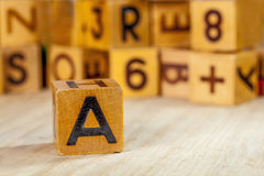 Old wooden block with capital letter A Stock Photos