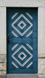 Old wooden blue door with ornament Royalty Free Stock Image