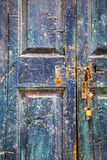 Old wooden blue door with padlocks Royalty Free Stock Photography