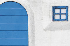 Old wooden blue door and window Stock Photography