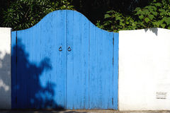 Old wooden blue gateway Stock Photos