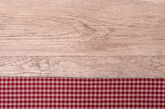 Old wooden board with checkered cloth. As background Royalty Free Stock Photos