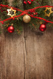 Old  wooden board with Christmas border. Stock Images