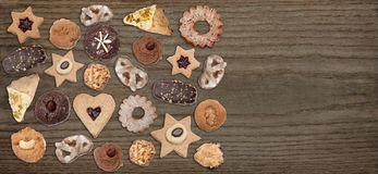 Old wooden board with cookies and copy space Royalty Free Stock Photography