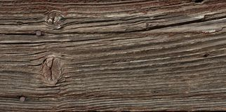 Old wooden Board with cracks and rusty nails Royalty Free Stock Photo