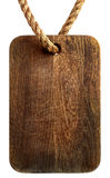 Old wooden board hanging on the rope Stock Photo
