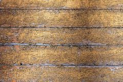 Old wooden board weathered grunge surface with cracked and peeling paint closeup as background royalty free stock image