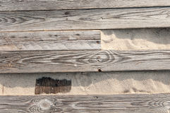 old wooden boards broken on the sand Stock Image
