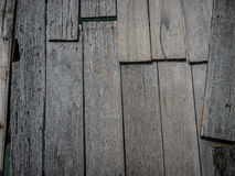 Old wooden boards on a jetty. Old wooden boards are nailed together over the ocean to make a rough jetty Royalty Free Stock Photography