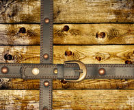Old wooden boards and leather belt Stock Photo