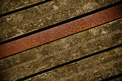 Old wooden boards with metal beam Royalty Free Stock Image