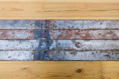 Old wooden boards and metal tape. Royalty Free Stock Photo