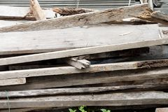 Old wooden boards. Old wooden boards left on outdoor after construction Royalty Free Stock Photo