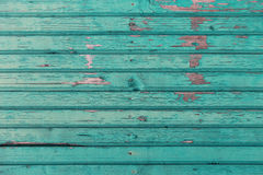 Old wooden boards painted in blue background Royalty Free Stock Images