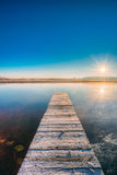 Old Wooden Boards Pier On Calm Lake, River. Autumn Season. Sunse Royalty Free Stock Image
