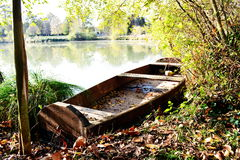 Old wooden boat anchored in lake Royalty Free Stock Images