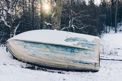 Old wooden boat ashore in winter Stock Image