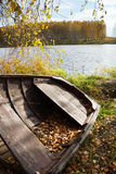 Old wooden boat at the autumn river Royalty Free Stock Photography
