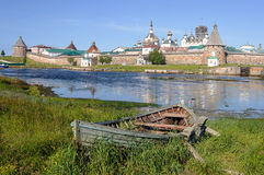 Old wooden boat on the backfround of Solovetsky monastery Royalty Free Stock Photos