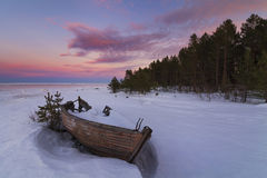 Old wooden boat. On the background of winter landscape Stock Photography