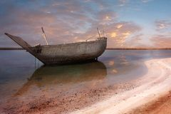 Old wooden boat in a bay warm colors Royalty Free Stock Photo