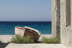 Old wooden boat on the beach in greece on beautiful summer day Royalty Free Stock Image