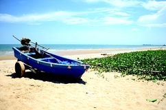 Old Wooden Boat on the beach at morning in summer season with ha. Rd light sunshine Royalty Free Stock Image