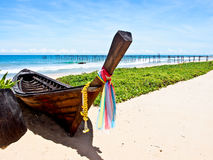 Old wooden boat on the beach Stock Photo