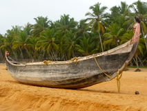 Old wooden boat on the beach Stock Photos