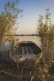 Old wooden boat. On calm river shore Stock Photos