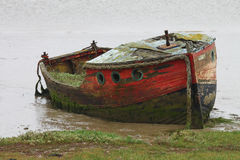 Old Wooden Boat. Decayed, Old and isolated Wooden Boat Royalty Free Stock Image
