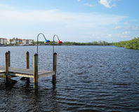 Old wooden boat dock by an inlet in Naples Florida royalty free stock image