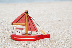 Old wooden boat figure on the beach in the evening Royalty Free Stock Image