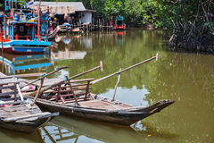 Old wooden boat in the fishing village Stock Photos