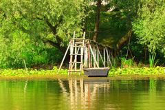 Old wooden boat fixed on dock Royalty Free Stock Photography