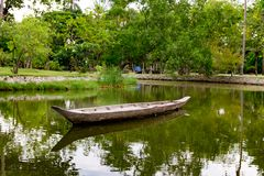 Old wooden boat floating in a river. The old wooden boat floating in a river Stock Images