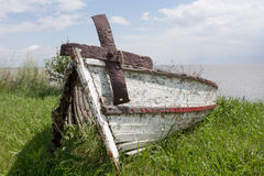 Old wooden boat. Front view of an old wooden boat and rusty anchor Royalty Free Stock Photos
