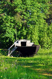 Old wooden boat on the green meadow Royalty Free Stock Images
