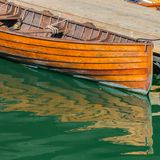 Old Wooden Boat and Green Water. In harbor marina Royalty Free Stock Photo