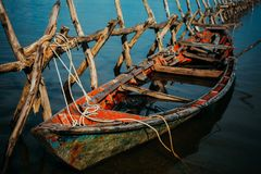 Old wooden boat has taken water stock images