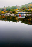Old Wooden Boat House on a Calm Lake in the Fall Royalty Free Stock Photo