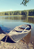 Old wooden boat at the lake Royalty Free Stock Images