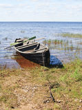 Old wooden boat on lake bank Royalty Free Stock Image