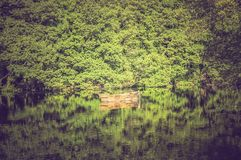 Old wooden boat on the lake Stock Photography