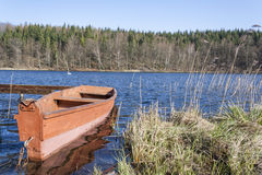 Old wooden boat on the lake shore Royalty Free Stock Image