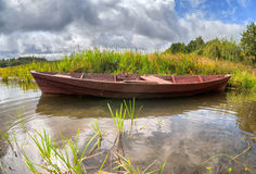 Old wooden boat at the lake in summertime Stock Photography