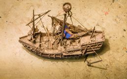 Old wooden boat model on the table. Royalty Free Stock Images