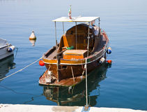 Old wooden boat moored at pier Stock Photos